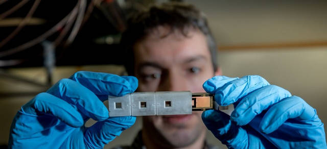 Georgia Tech Research Institute Research Scientist Robert Wyllie holds a 3D printed enclosure containing tiny electric heaters and a vapor cell holding rubidium atoms. (Photo Credit: Branden Camp, Georgia Tech Research Institute)