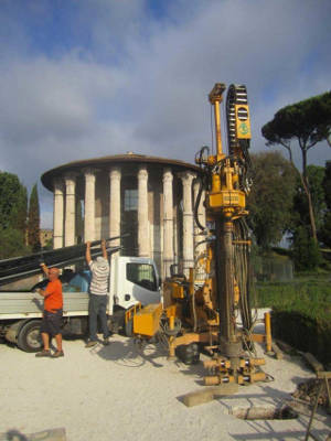 Researchers used a hydraulic drilling rig to take core samples behind the Temple of Portunus in 2015. Image credit: Andrea Brock