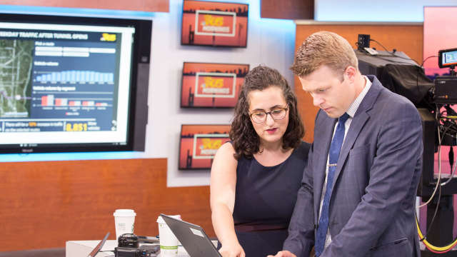 Taylor Mirfendereski, left ,and Jake Whittenberg at the KING newsroom in Seattle. Image courtesy of Ben Rudolph