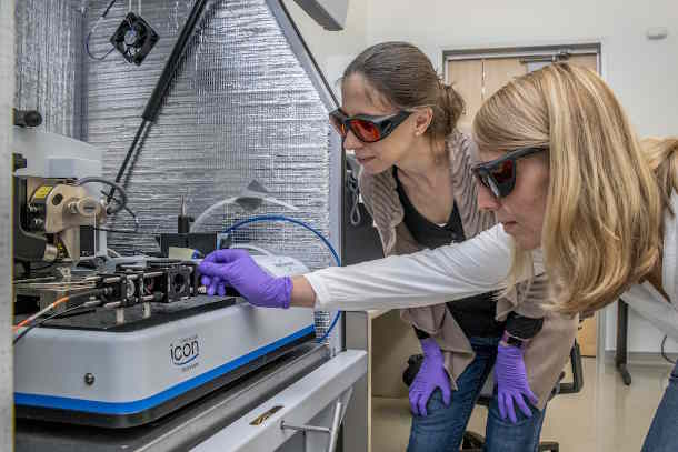Berkeley Lab researchers Francesca Toma (left) and Johanna Eichhorn used a photoconductive atomic force microscope to better understand materials for artificial photosynthesis. (Image credit: Marilyn Chung/Berkeley Lab)