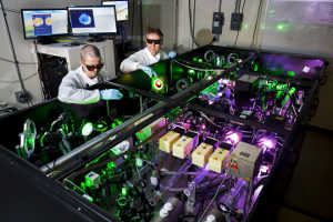 Anatoly Maksimchuk, EECS Research Scientist, and John Nees, EECS Associate Research Scientist, demonstrate use of the HERCULES 300 TW laser. Image credit: Joseph Xu